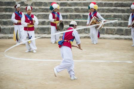 folk village: Seoul, South Korea - January 28, 2016: The ending of the traditional Korea farmers dance at the Korean folk village in Yongin, Korea on January 28, 2016. The farmers dance occurred to celebrate the harvest in Korea.