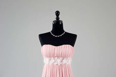 frill: Modern pink wedding dress isolated on Grey background