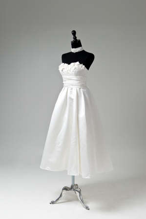 Modern white wedding dress isolated on Grey background Stock Photo