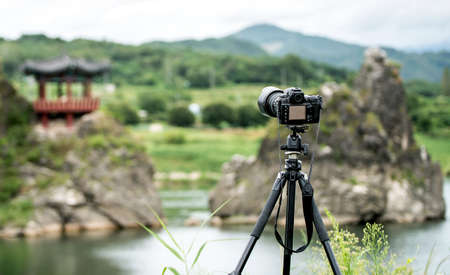 tripod mounted: Photo camera mounted on tripod outdoors, South Korea