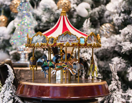 christmas decoration carousel horses christmas presents on wooden table stock photo 69530929