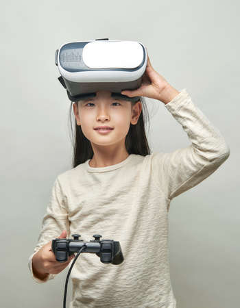 Smiling girl with glasses of virtual reality Stock fotó