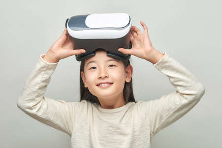 Smiling girl with glasses of virtual reality 스톡 콘텐츠