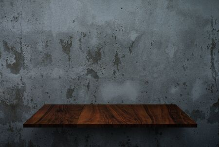 Empty wooden shelf on concrete wall texture photo