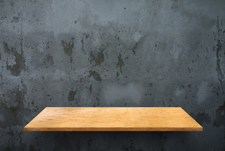 empty shelf: Empty wooden shelf on concrete wall texture Stock Photo