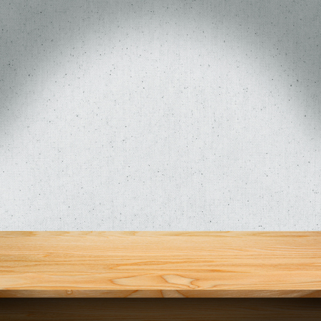 Wood table with fabric texture background Standard-Bild