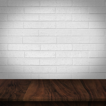 Wood table with White brick wall background Stock Photo