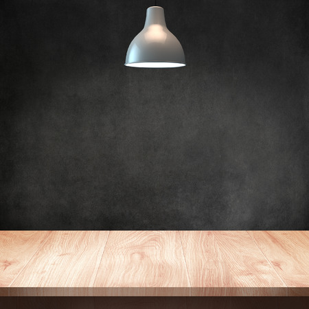 Wood table with Lamp and dark wall background Standard-Bild