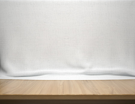Wood table with white cotton fabric background 版權商用圖片