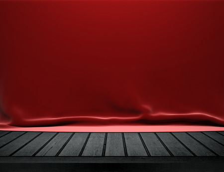 Wood table with red velvet cloth background Imagens