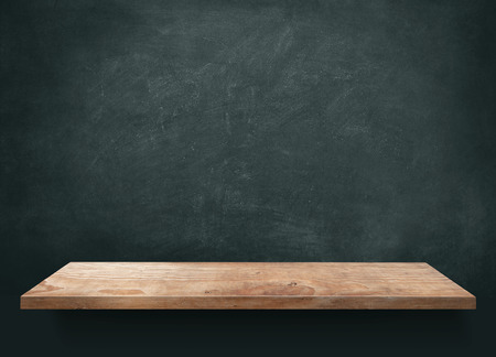 old school: Wood table with blackboard background