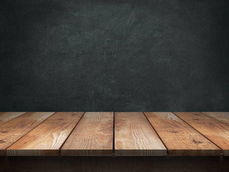 Wood table with blackboard background Zdjęcie Seryjne - 44134060