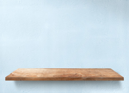 Wooden table with light blue wall Stock Photo