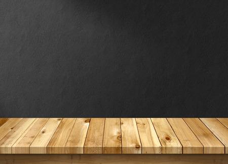 Table en bois avec du noir mur fond