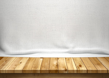 Wood table with white fabric background