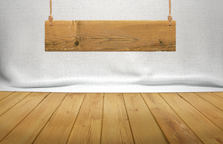 Wood table with hanging wooden sign on white fabric background