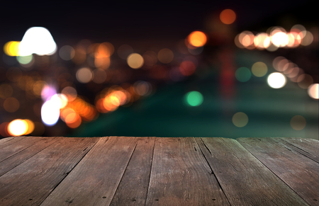 Wood table with city lights night blurred background