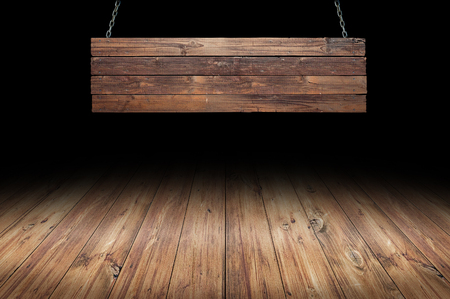 wood floor: Wood table with hanging wooden sign