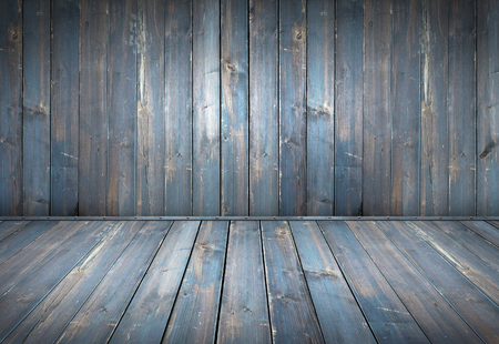 Blue painted wood table with wooden wall background
