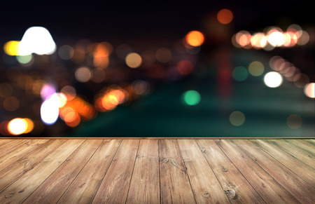 Wood table with city lights night blurred background 版權商用圖片 - 46731990