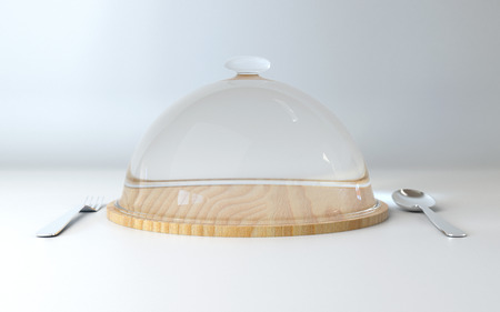 Glass dome on wooden plate with spoon and fork for your food display