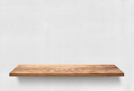 Wooden shelf on white wall Stock Photo