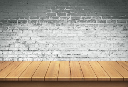 Wood table with White brick wall background Standard-Bild