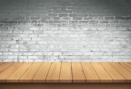 ladrillo: Mesa de madera con fondo de pared de ladrillo blanco Foto de archivo