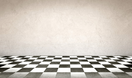 Concrete wall and checkerboard floor