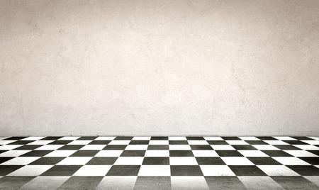 checkerboard: Concrete wall and checkerboard floor
