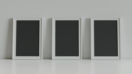 Blank picture frame with table and wall background. 3D rendering.