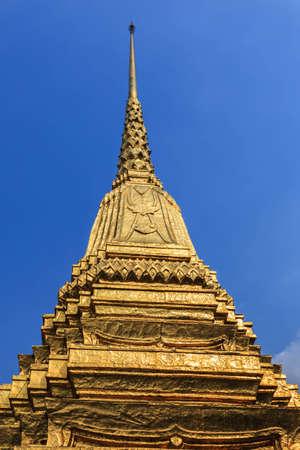 Golden pagoda with blue sky.