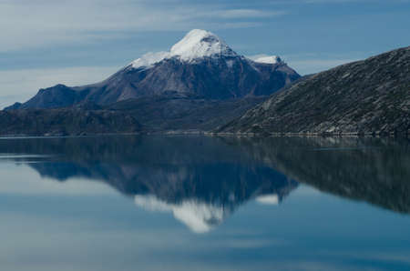 immense: Kuunnaat mountain and reflection in the fjord, in Greenland