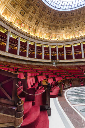 Paris, France December 27, 2012: Empty hemicycle of French national assembly with red seats