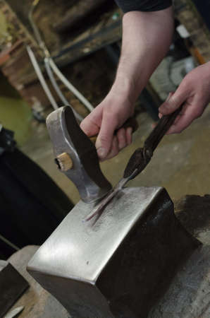 beating: Black smith beating hot steel knife Stock Photo