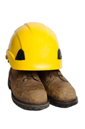safety boots: Used leather safety boots and yellow hard hat isolated on white background