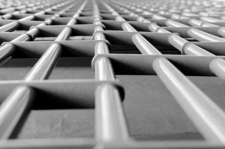 grates: A steel metalic grid  blurring into the distance