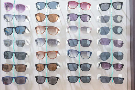 beautiful eyes: Sun Glasses on a wall in an optician shop