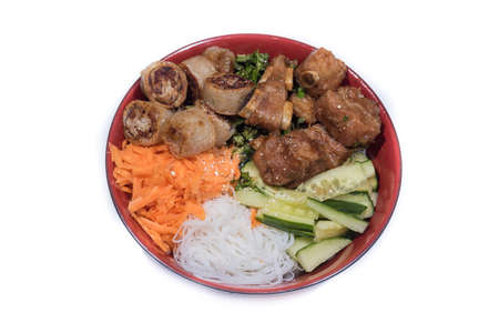 porc: Bowl of beef Bo bun with salad, porc ribs, fresh herbs Stock Photo