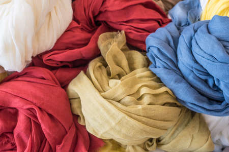 confortable: Stack of different colorfull tagelmust Stock Photo