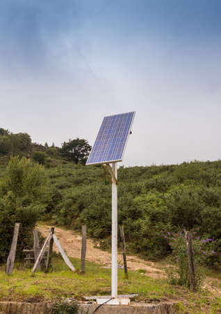 pannel: Solar pannel installation on a mast in the countryside with bushes