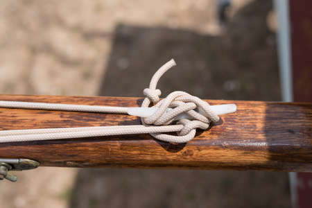 cleat: A line tied to a horn cleat on a wooden boat mast