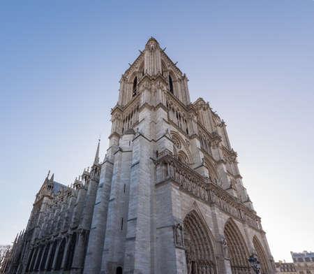 cite: Notre dame de Paris perspective view on a blue sky, Paris, France
