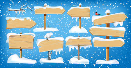 Set of wooden street signs in the snow