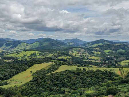 Aerial view of green tropical mountain and small valley in Monte Alegre do Sul in the state of Sao Paulo in Brazil. Reklamní fotografie