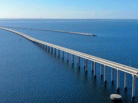 Aerial view of Sunshine Skyway, Tampa Bay Florida, USA. Big steel cable suspension bridge.