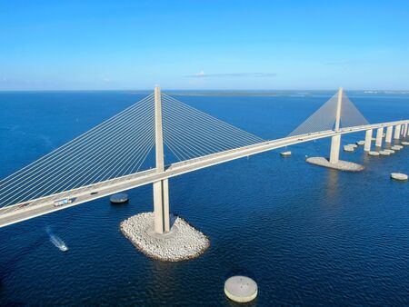 Aerial view of Sunshine Skyway, Tampa Bay Florida, USA. Big steel cable suspension bridge.