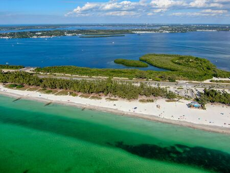 Aerial view of Coquina Beach white sand beach and turquoise water in Bradenton Beach during blue summer day, Anna Maria Island, Florida. USA Stock fotó