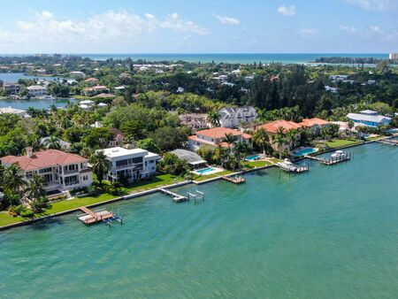 Aerial view of Bay Island neighborhood and luxury villas next the ocean, in Sarasota, Florida, USA