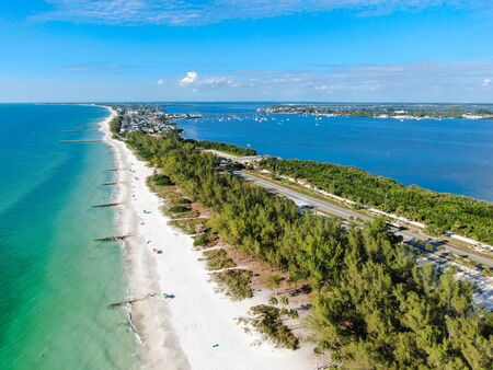 Aerial view of Anna Maria Island, white sand beaches and blue water, barrier island on Florida Gulf Coast. Manatee County. USA Stock Photo